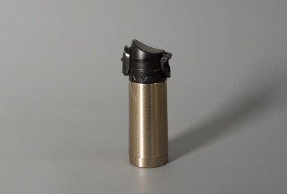 Thermos flask in champagne